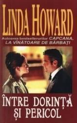Intre dorinta si pericol - Linda Howard Carti